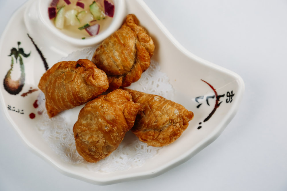 Curry Puff - Crisp puff pastry filled with curry chicken , fresh cucumber relish topped.