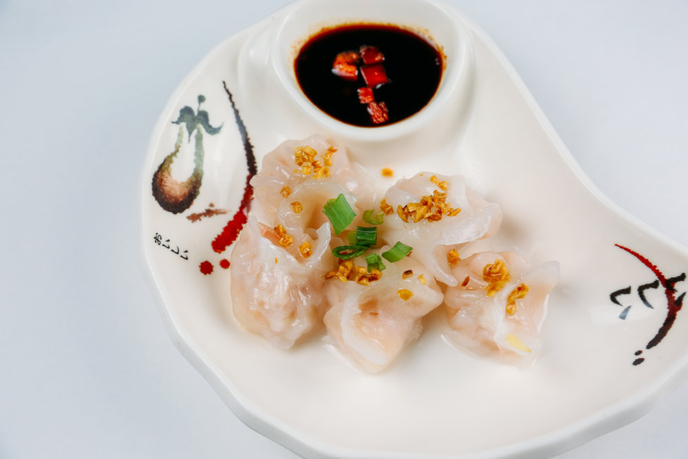 Steam Dumpling - (Chicken, Shrimp, Veggie)Steamed dumpling with soy vinaigrelle.