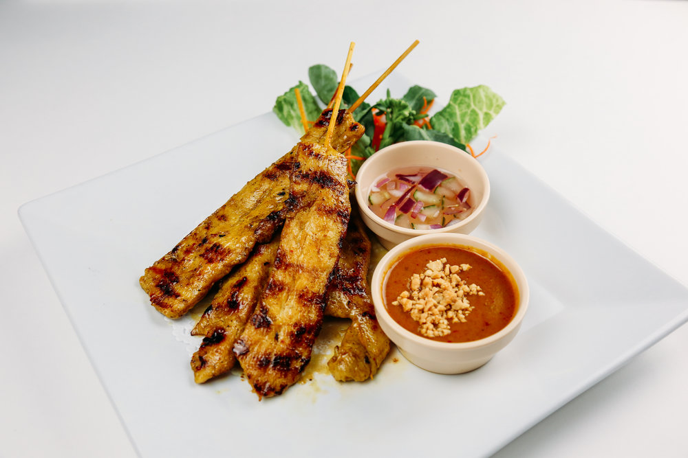 Chicken Satay - On skewers with peanut sauce and cucumber salad.