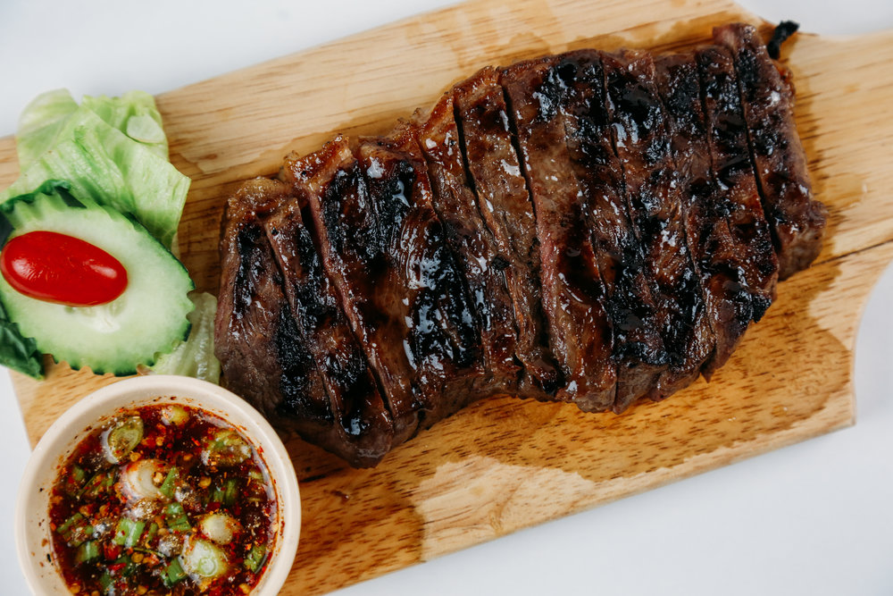 BBQ BEEF WITH JEAW SAUCE - Grilled marinated beef with Thai spicy sauce.