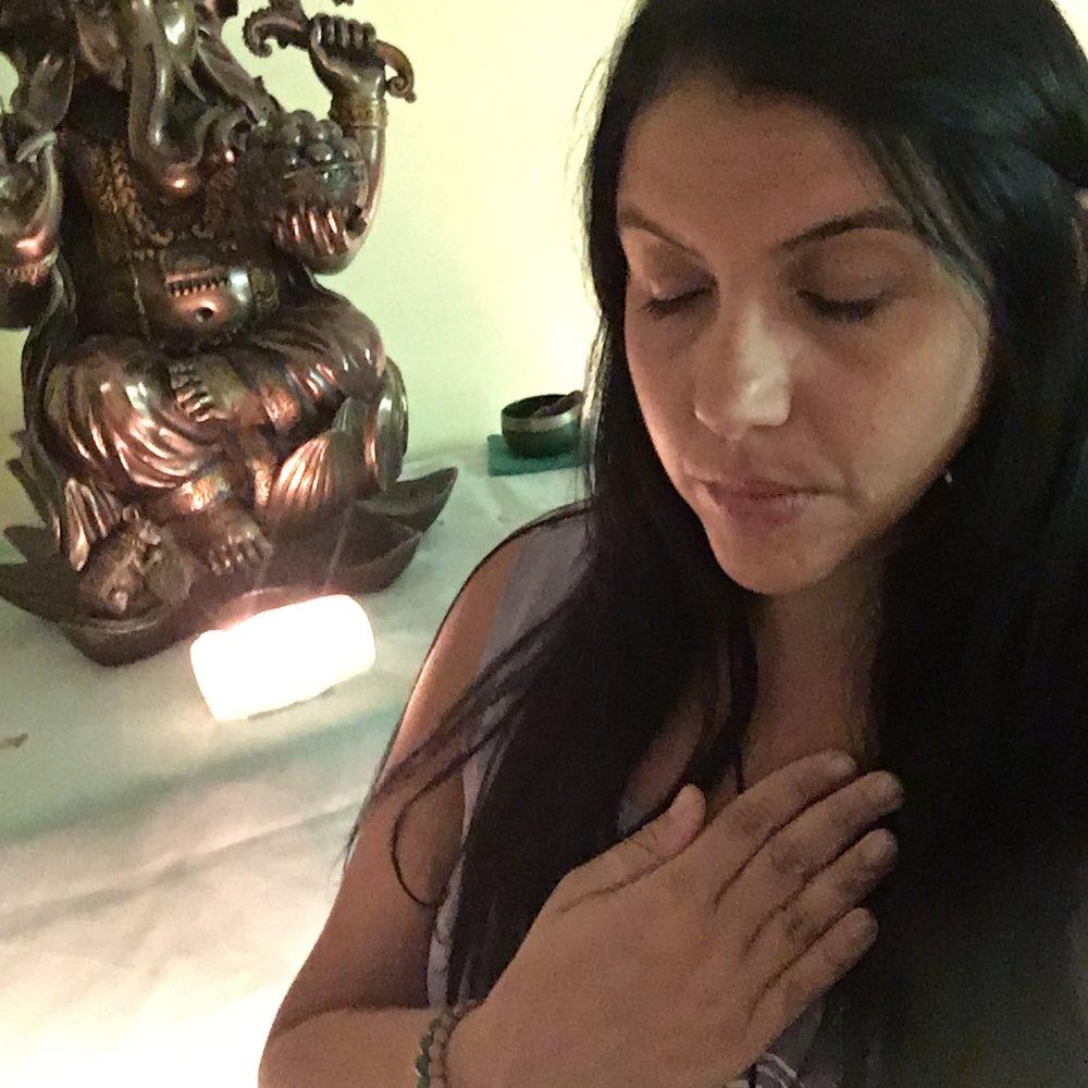 Doing seated pranayama (breath work)