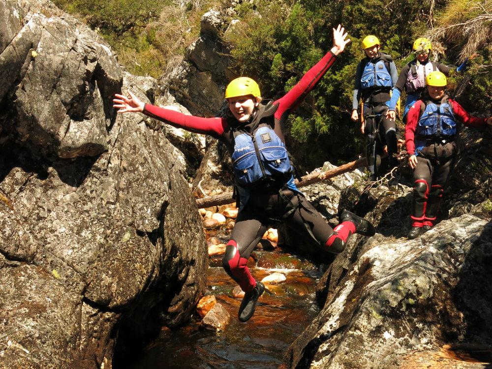 Water jump in Lost World Canyon, Cradle Mountain, Tasmania