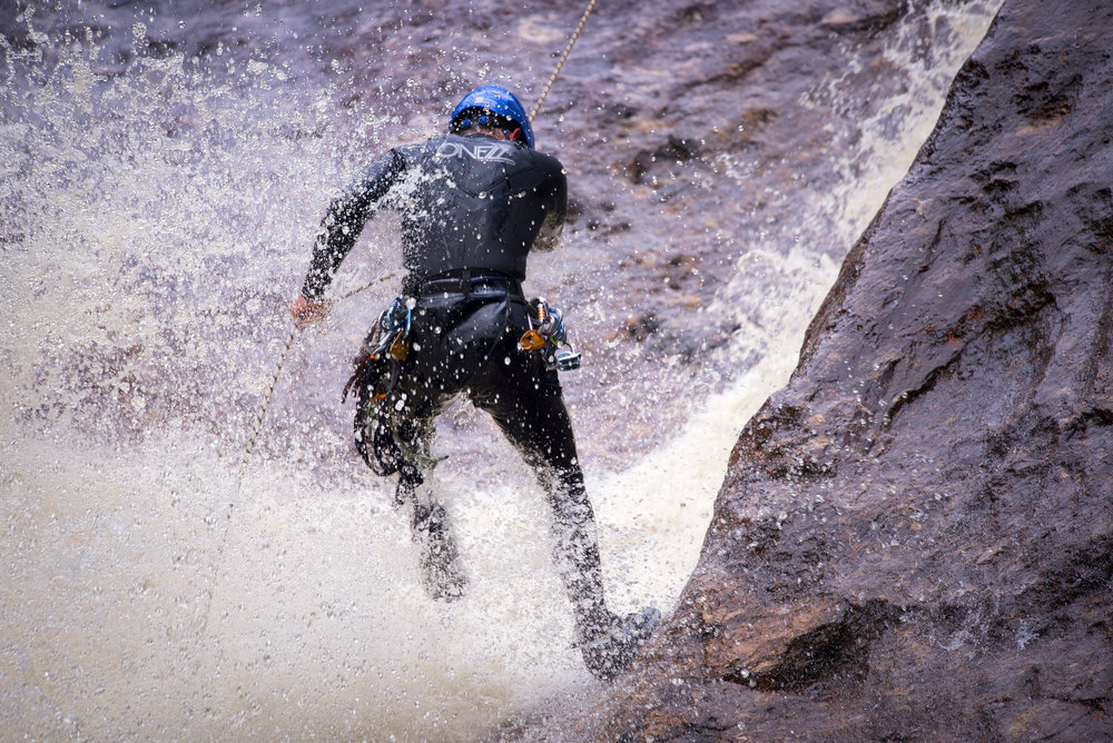 Abseiling through the waterfall in Machinery Canyon, Tasmania