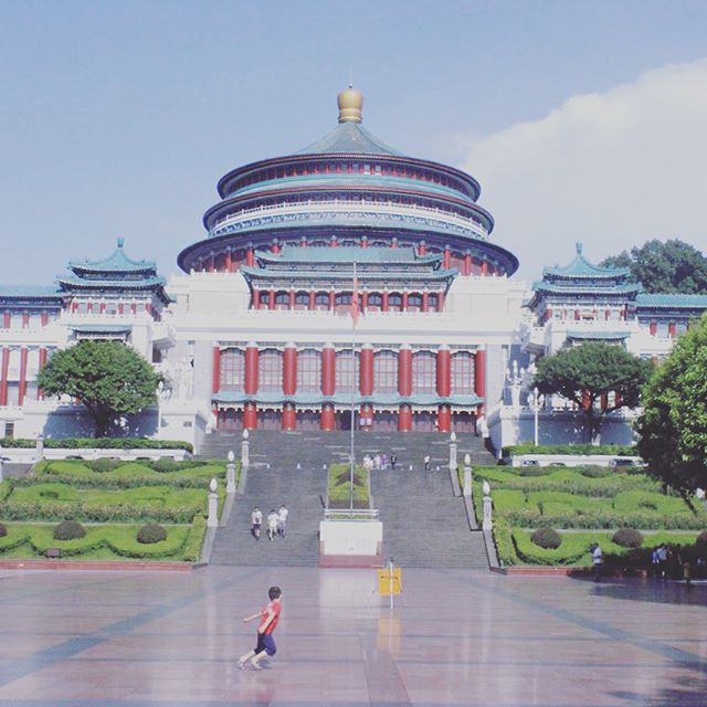 Day 60. Construction of the Great Hall of the People was completed in April 1954 under the directive of Deng Xiaoping, First Secretary of the Communist Party's Southwest Bureau at the time. Today the Hall still forms the meeting place of the municipal legislative bodies of Chongqing - the People's Congress (Renda) and People's Political Consultative Conference (Zhengxie). Between this brief parabola of 1954 to today, the economic and social fabric of Chongqing would alter drastically around it, but when we visited the Great Hall was still the same as it was then. Its dome opens impressively to a hot sun still. Walking through its bold doors to sit looking in at a strange emptying stage, I got the overwhelming sense of sitting in a paradox. On one, an overwhelming sense of quiet, enclosure and introspection in concentric circles curving to a sole point on the roof. On the other, a raucous sense of the open dome, the enveloping entry of light, space and heat  from the outside. You get the sense that Deng Xiaoping would in many respects never forget this building on the Yangtze as he proceeded to re-weave China through the paradox of increasing openness with insularity dynamics. But who am I to say, I did not know Deng, nor China then as now, we are chasing chimeras across an eviscerating frame. Yet the feel of that great unchanging hall with all the fabric outside ablow sticks, this surreal assembly point of the paradox that opens closed. And then, perhaps we might learn a little from this grand-diminutive dome on the Yangtze: of the BRI and its paradox of an open-closed construction, building in contradictions at the heart of someone other's sun. @jeep @fca_group @csis @magellancapitaladvisors @uniofstandrews #silkroad #chongqing #beltandroad #paradox #China