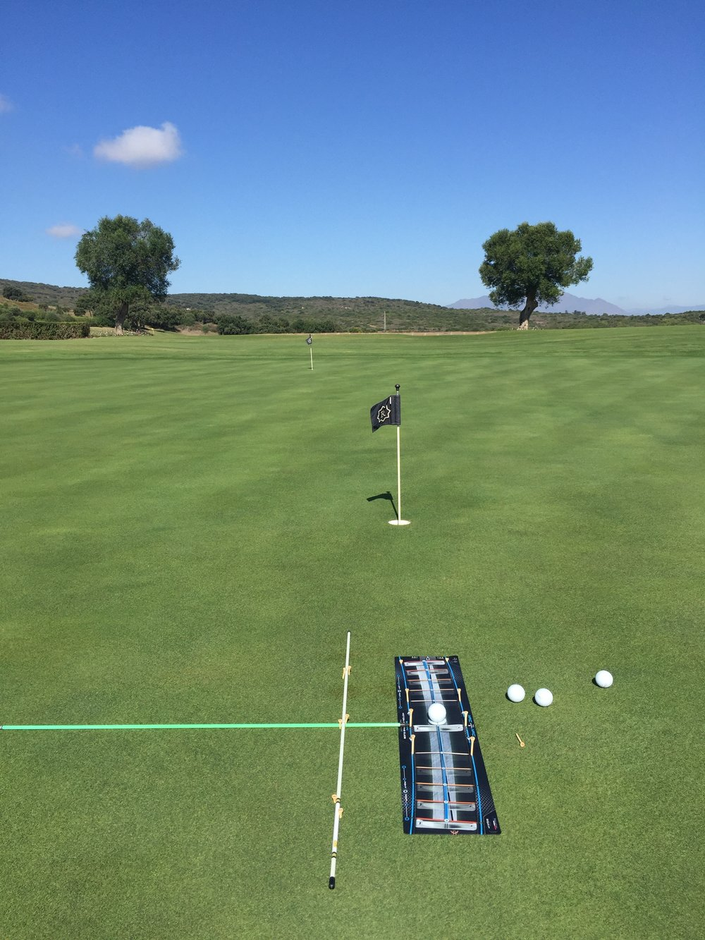 For me it is crucial to practice my stroke with a perfect set up. That is why I always set up my alignment sticks to the same distance from the ball and same stance width on my feet. To acknowledge what worked best for my stance (distance from the ball and stance width, I had my coach Jorge Parada ( @jorgeparadagolf ) test me of it. If interested I will ask him details and maybe write a blog about it.