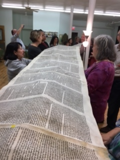 At Simchat Torah we unroll and revel in reading excerpts of the whole Torah before we reroll it for the New Year