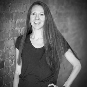 """Rebecca Johnson E-RYT® 200, YACEP®, Owner   Rebecca grew up in Yankton and has been teaching yoga here for over 10 years. She started doing yoga in 2005 and was soon hooked on how yoga improved her body image, strength and self esteem. """"It helped me to begin to appreciate what my body could do and worry less about what it looked like,"""" Rebecca says. Inspired to help others experience the same — and with the dream of some day opening a studio in Yankton — she completed a 200 hour training at Omaha Yoga & Bodywork Center (now called Yoga Now) in 2008. Rebecca's passion for yoga and holistic wellness has led her to many workshops, including trainings to teach children's and prenatal yoga. She also completed a 100 hour training with Jason Crandell at Love Story Yoga in San Francisco on Creating Space and Freedom: Hips +Legs in 2017. Rebecca is married to an extremely supportive husband and dog mom to a spoiled Boston terrier named Yoda."""