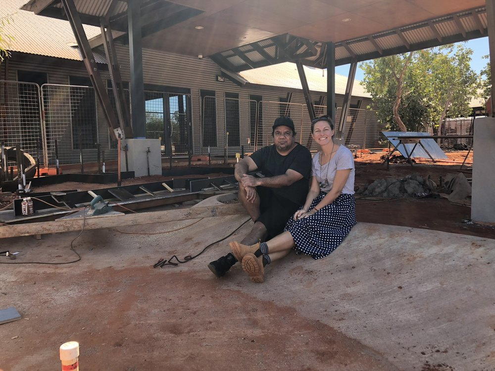 Artist Michael Torres and Vanessa Margetts sitting on the edge of Michael's tidal artwork (under construction) at Nyan-ngan Nyirrwa. Photo Steve Pearse.jpeg