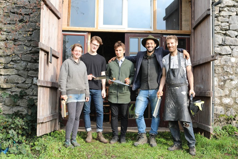 A class group photo outside workshop with Charlie Whinney