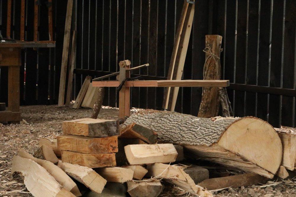 Logs after splitting piled in blanks