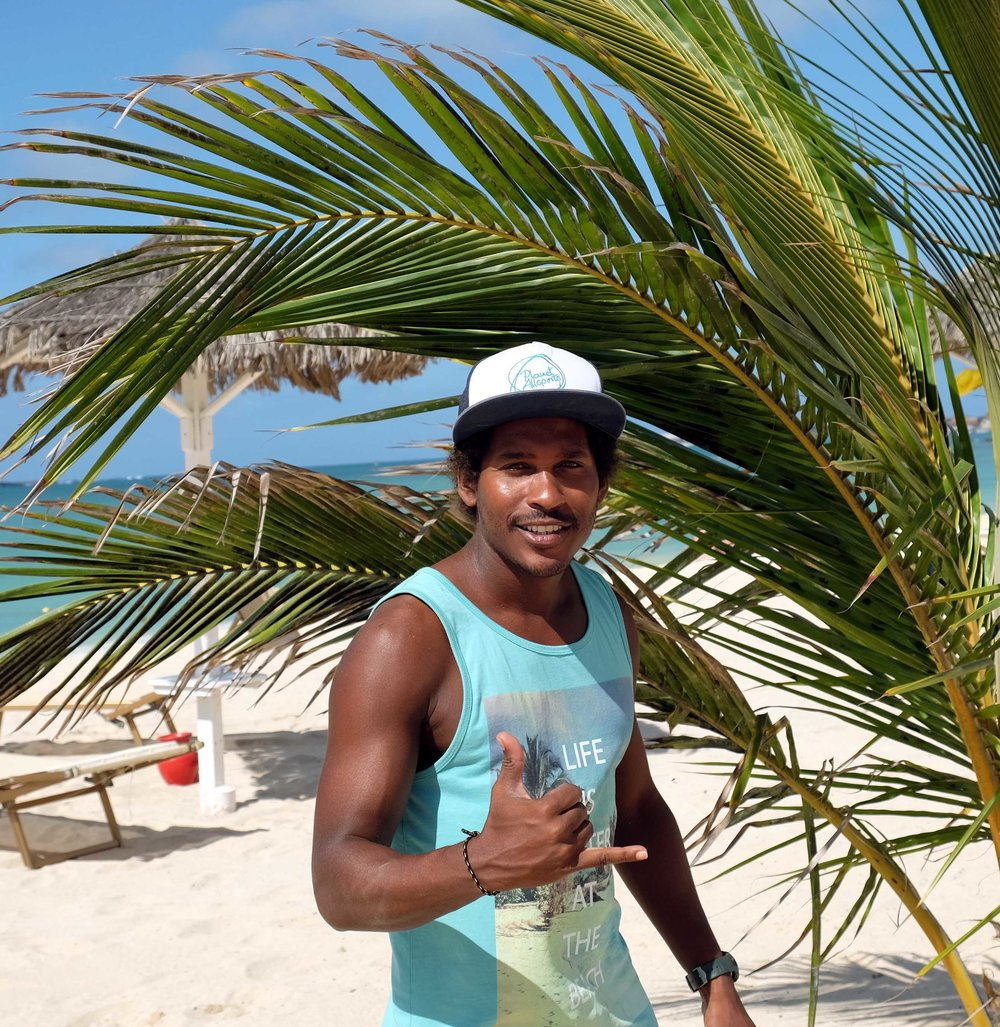 Pulitcha Brito Santos. (Pulica) From day one always supportive and engaged in our project. He surfs the waves with style and just picked up kitesurfing too! He knows every corner of the island and helped us a lot in dealing with authorities, spreading our promotion throughout the Island and getting things done when it seemed impossible.