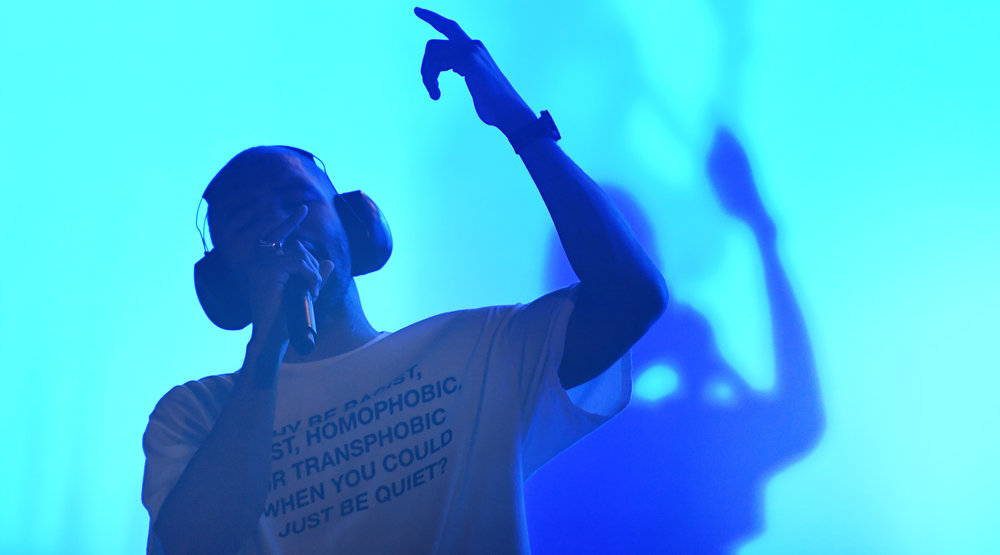 Frank Ocean - On July 28th, Frank Ocean took the stage wearing a shirt that said 'WHY BE RACIST, SEXIST, HOMOPHOBIC OR TRANSPHOBIC WHEN U COULD JUST BE QUIET?'. The normally reserved icon used his shirt to yell for him and everyone heard him.