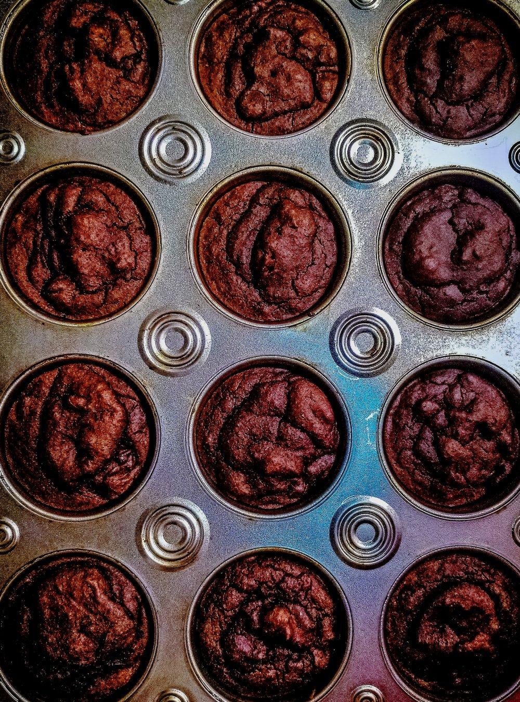 Date-sweetened gluten-free brownies in muffin pan