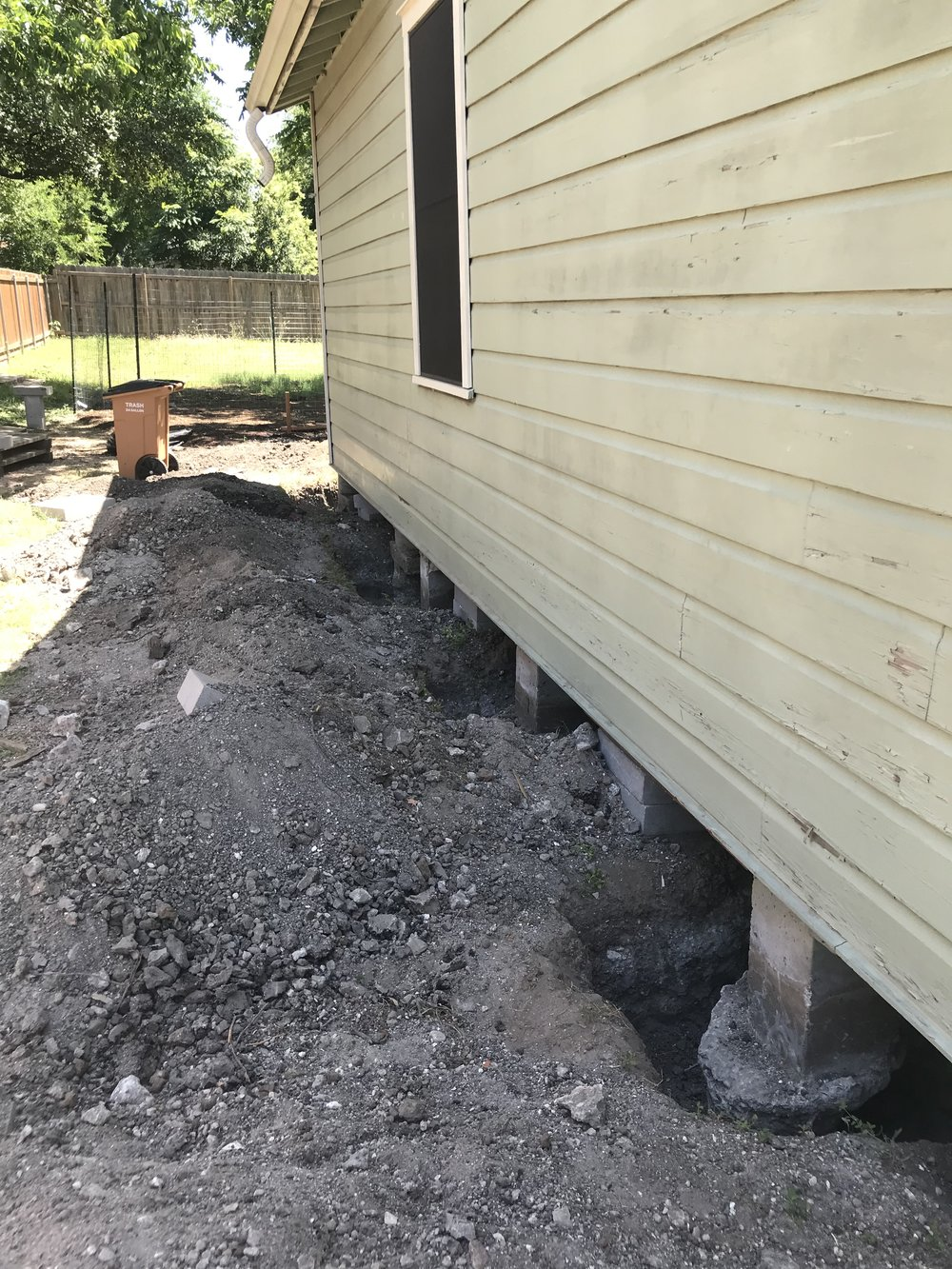 Digging new footings - It turns out the existing piers had no footings (!), so we had to dig around the piers so we could pour new ones. We are adding a second floor to the house, so the piers will have to take on extra load.
