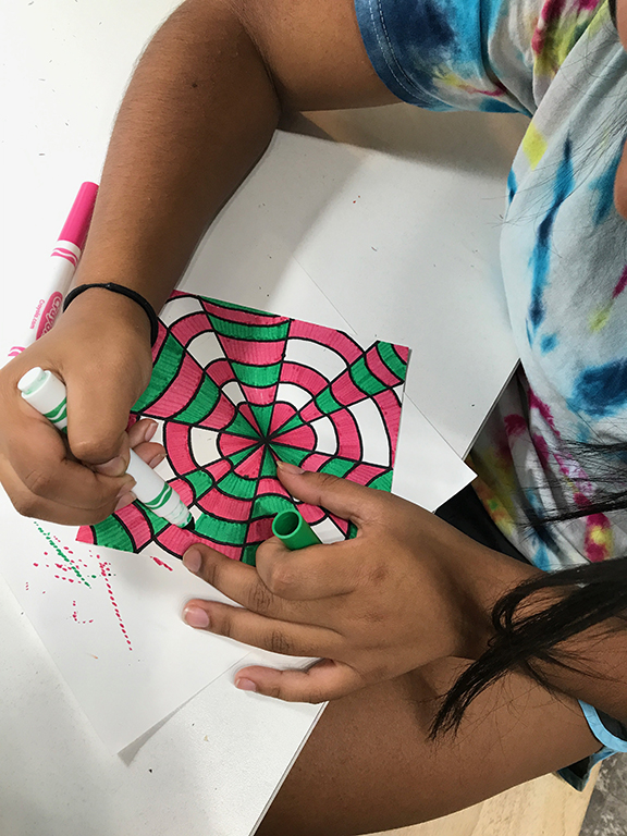 Elizabeth works on an Op Art project.