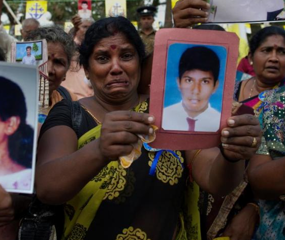 sri lanka anguish woman.png