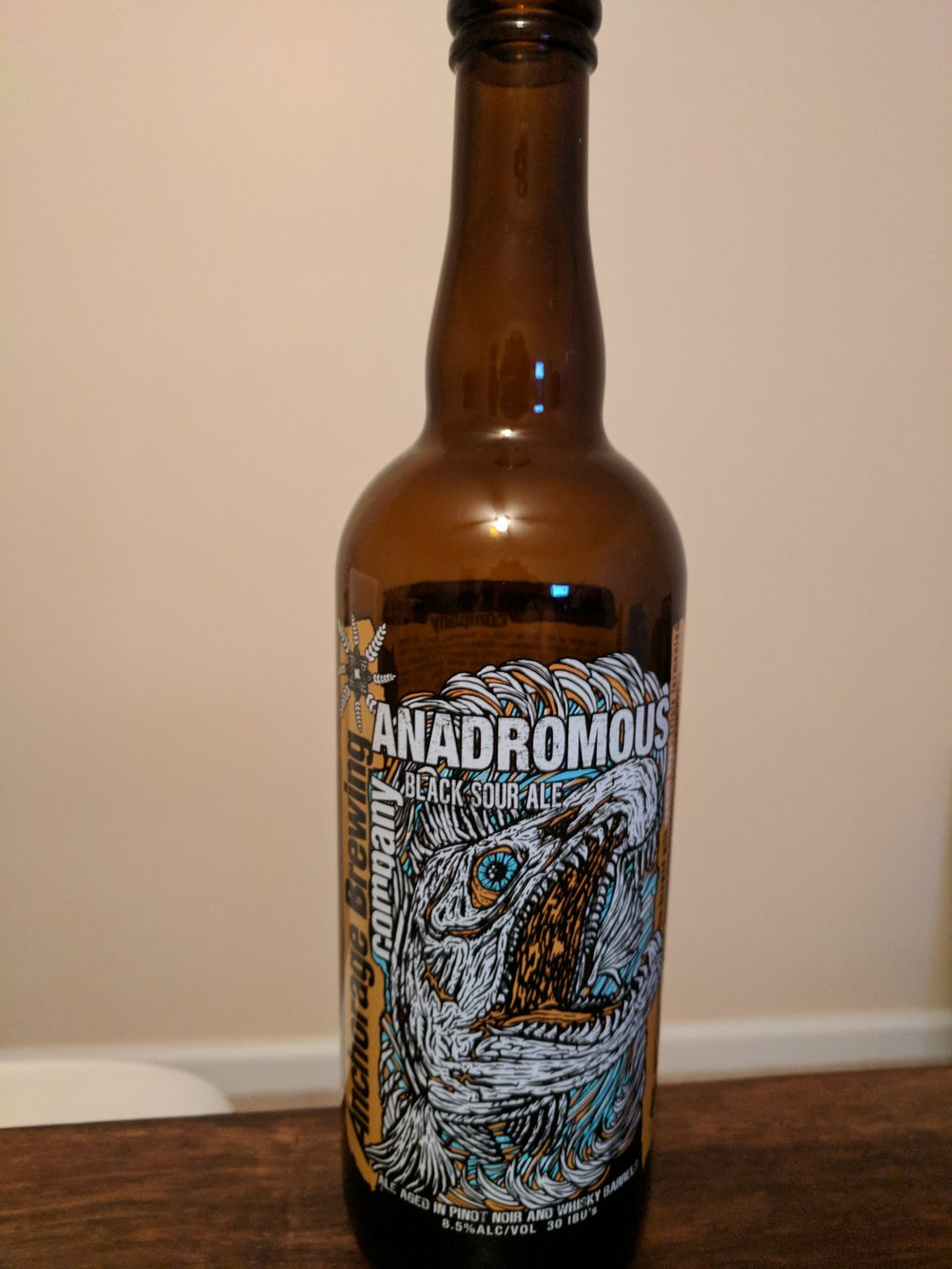 Anchorage Brewing Anadromous - The Anchorage Brewing Anadromous is a Black Sour Ale.  We tasted this beer on Episode 14, where you can hear our live thoughts and impressions.  This beer can be a bit of a novelty to some, while being a bit harsh to others.  It has the appearance of a dark stout, but the body and flavor of a much lighter ale.  It has a head that is conducive of a normal sour ale.  The aroma leaves much to be desired, personally; particularly because I am such a fan of sour beers.  With that being said, this beer delivers on its sour flavor, while still maintaining a bit of that roastiness from the malt.  The sour just about overpowers the roasted malt that comes through.  As sours go, I prefer more