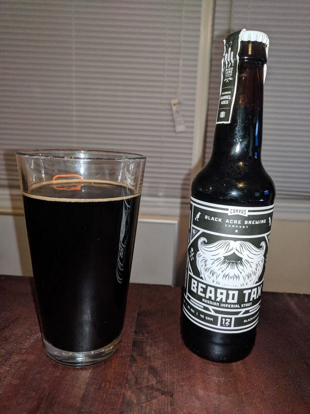 Black Acre Beard Tax - We tasted Beard Tax by the Black Acre Brewing on Episode 18.  It is a heavy Russian Imperial Stout.  While it is not an exact replica of the iconic Old Rasputin, this is a fantastic example of the style.  The dark malt really darkens this beer and provides the heavy mouth feel.  The after taste is present, but conversely is quite pleasant.  Very chocolaty and bitterness to accompany that.  This has less hop bitterness than sometimes comes through in a Russian Imperial Stout.  Joel personally likes this better, as the chocolate bitterness is better.  Scott actually really liked this beer, surprisingly, so we have been growing his pallet!  Nick thought this was pretty good, but Dylan thought it was not bad.
