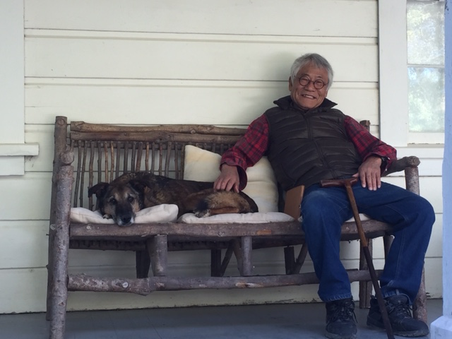 Shiro Otani and Nico relaxing on the porch.