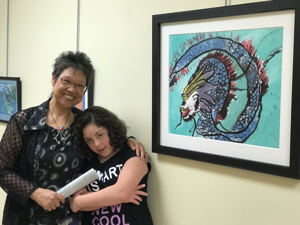 Sophia & Hsi Mei Yates posing with Sophia's dragon at an art show