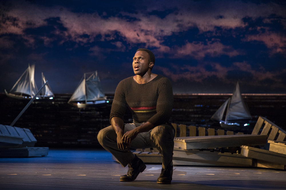 Joshua Henry in CAROUSEL; sets by Santo Loquasto. Photo by Julieta Cervantes