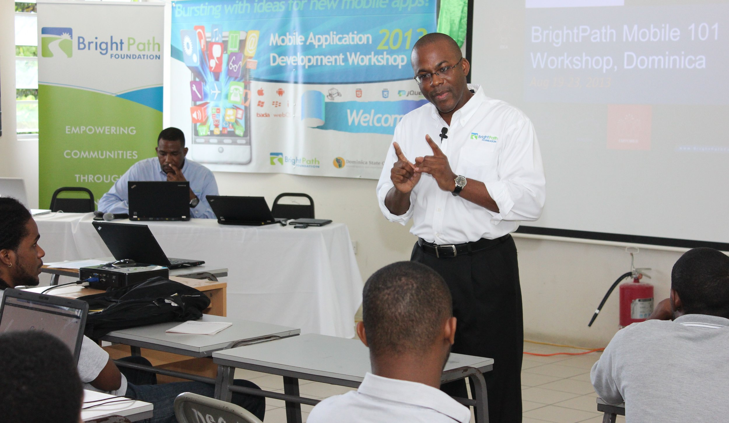 BrightPath Founder Bevil Wooding (standing) addresses participants at the Dominica Mobile App Workshop hosted by Dominica State College, Roseau from August 17-24, 2013. PHOTO COURTESY BRIGHTPATH FOUNDATION.