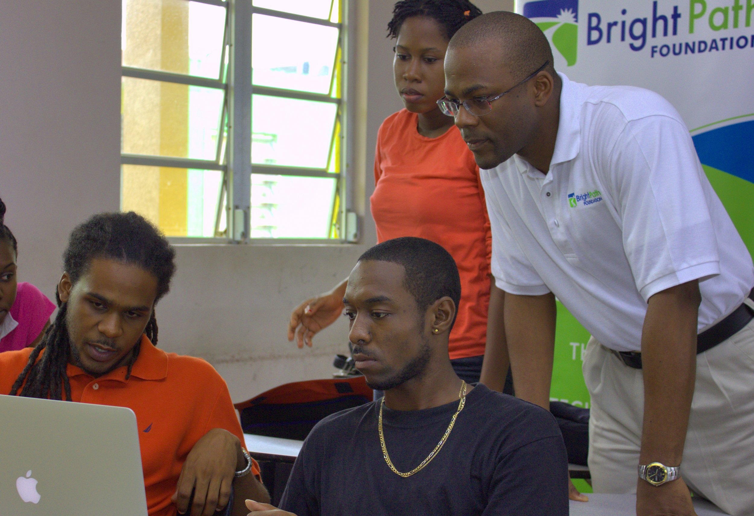 BrightPath Executive Director Bevil Wooding, right, guides participants in the Dominica Mobile App Workshop, which runs from August 19 to 24 at Dominica State College, Roseau. Photo courtesy BrightPath Foundation.