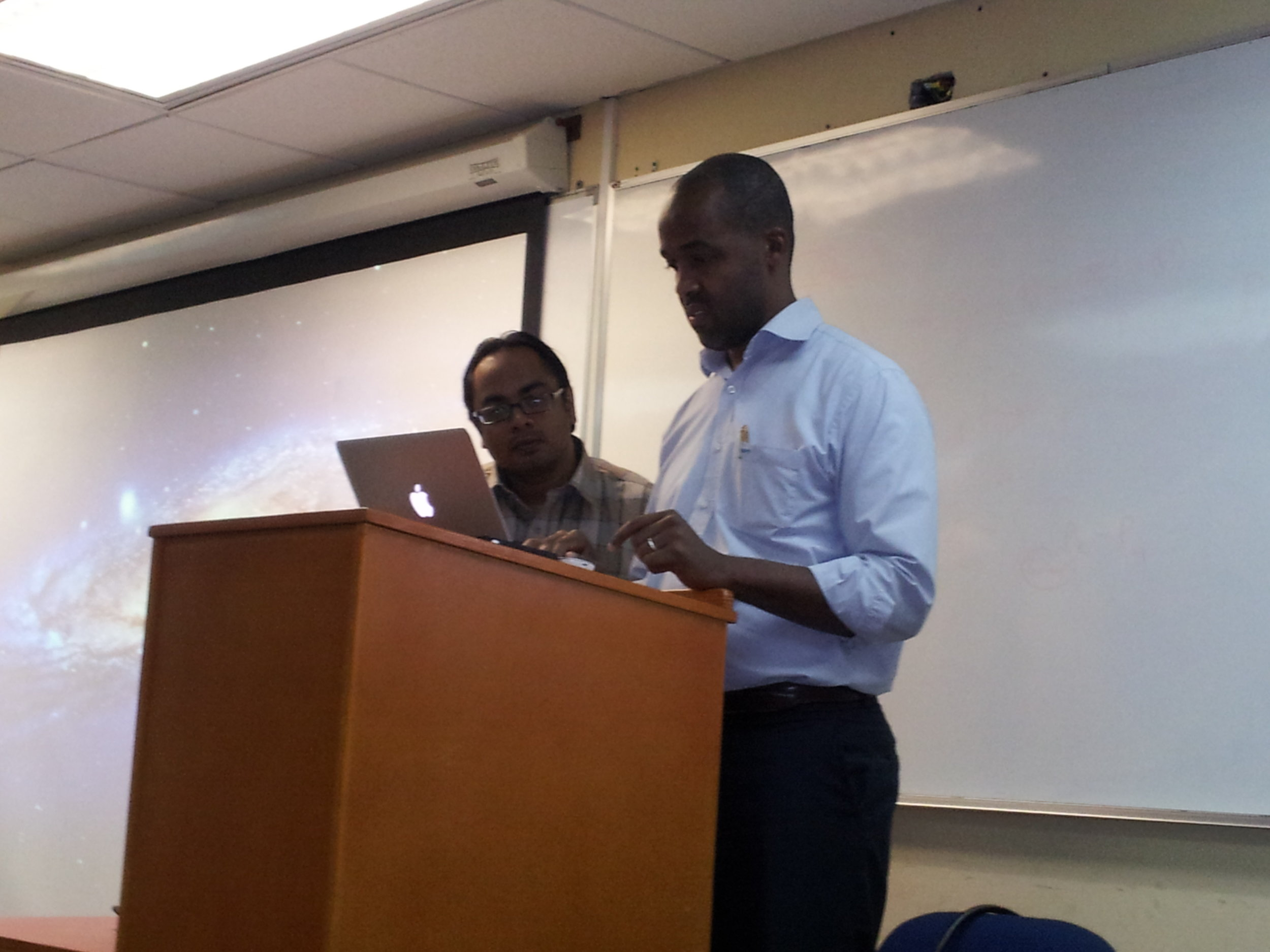 CAPTION: Dr Kenfield Griffith, CEO, mSurvey and Anil Ramnanan, PhD student at The University of the West Indies (UWI) Department of Computer Studies, at mSurvey's workshop on Data Collection and Surveying using Mobile Technology, held at the Max Richards Building, Faculty of Engineering , UWI St Augustine on March 28, 2014. PHOTO: GERARD BEST