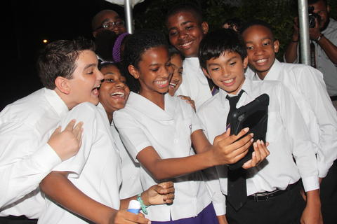 NorthGate College Form 2 and 3 students, from left, Brian Ripoll, Charise Laveau, Zachary Joel, Chaela Wooding, Shanade Ali, Deron Khelawan, James Mohammed and Arendele Owen celebrate after receiving the Top Design Award in the Cubes in Space global competition in a formal ceremony held at the residence of the Canadian High Commissioner, Fairways, Maraval, on September 26. PHOTO: ANDRE ALEXANDER