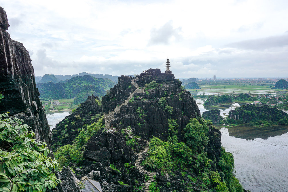 A small temple at Hang Múa overlooking the Ninh Binh rice fields.