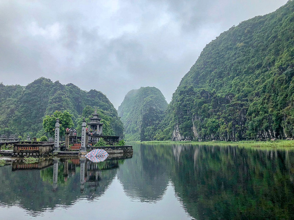 The Tam Coc boat tour takes you by an old cemetery, under three caves, and through many rice fields.