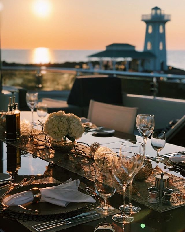 Sunset dinner with a view 📍Fox Harb'r Resort, Nova Scotia . . . . . #yacht #motoryacht #yachting #boat #boating #boatlife #yachtlife #tabledecor #tablesetting #sunset #sunsetvibes #summer #lighthouse #tablescape #westport #marina  #decoration #inspiration #love #style #vacation #travel #explore #wanderlust