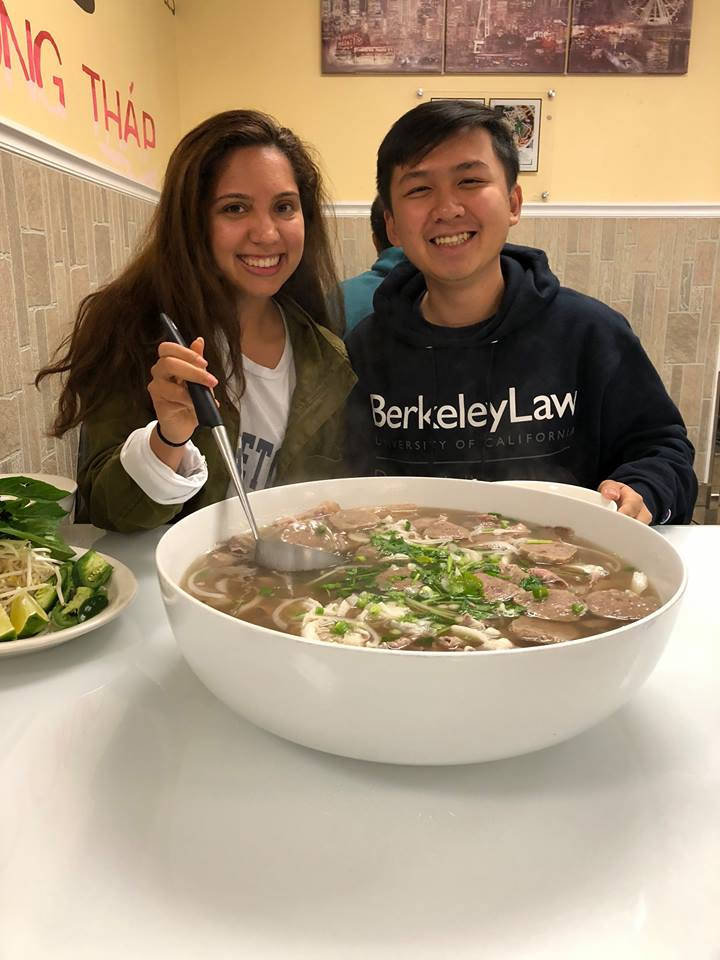 Carolina Sosa (2014) enjoys a GIANT bowl of Pho noodle soup with Anh-Tu Lu (2015).