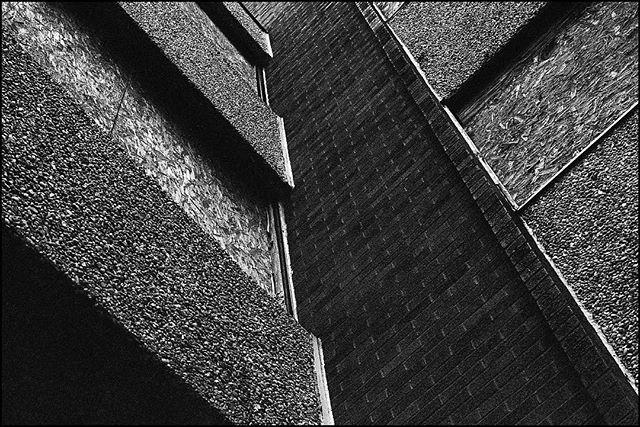 fascinated by angles and textures. • Nikon F2 Nikkor 50mm f/1.4 Ilford hp5+ • #nikonf2 #ilfordhp5 #ilfordphoto #blackandwhite #architecture #film #filmisnotdead #filmisalive #filmphotographic #photofilmy #filmphotography #heyfsc #filmcommunity #ishootfilm #believeinfilm #buyfilmnotmegapixels #35mm #35mmfilm #analog #analogphotography #filmcommunity #justgoshoot #staybrokeshootfilm #shotonfilm