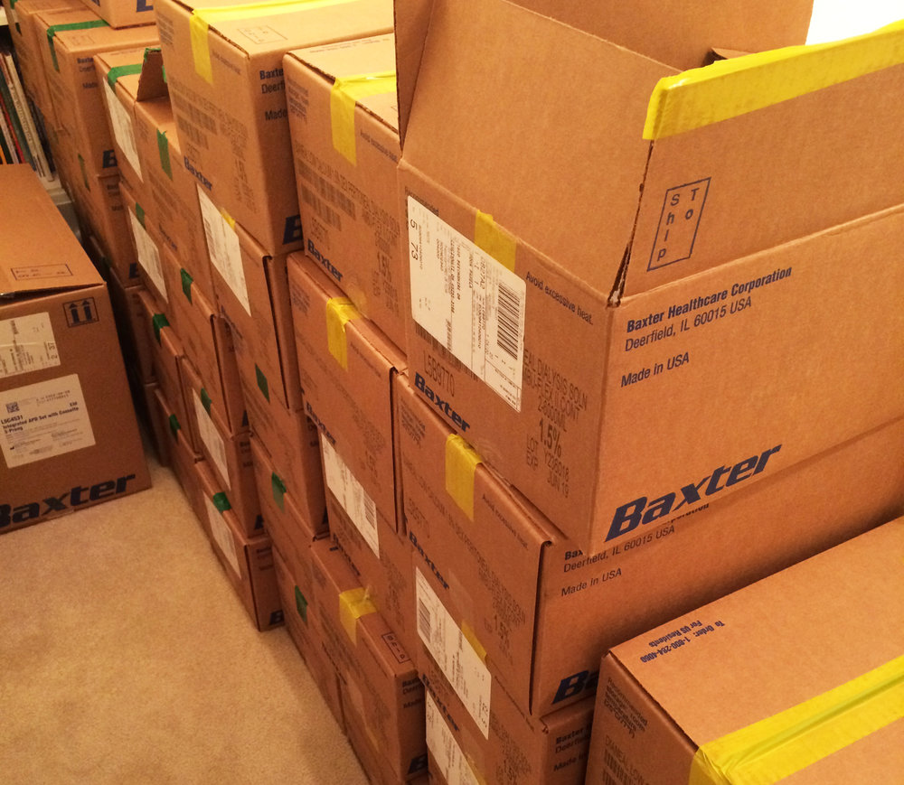People on home dialysis have to keep a month's supply of dialysis solution in their home. That means storing up to 30 boxes. These boxes lined the hallway between bedrooms.