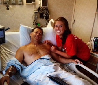 Morgan Mcvey with her hero and dad just hours after Scott's surgery.