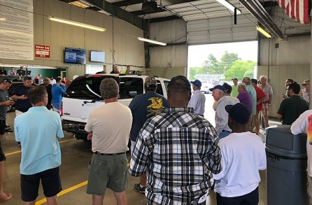 Dealers check out a vehicle running through the sale at Greenville Auto Auction