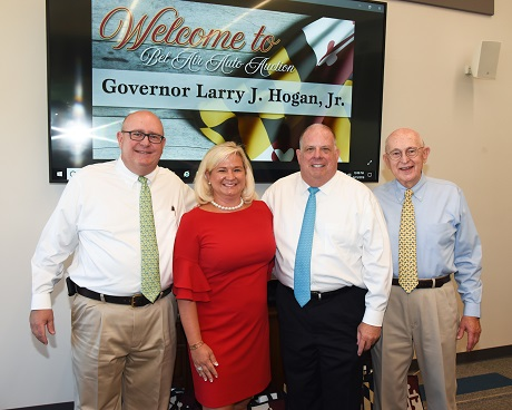 Governor Larry Hogan (2nd from right) visits with the Nichols family during his tour of BSC America's Bel Air Auto Auction in August.  He paused for a photo with (left to right) R. Charles Nichols, BSC America's President; Michelle Nichols-Neff, Executive Vice President, and Raymond Nichols, Chairrman and CEO.