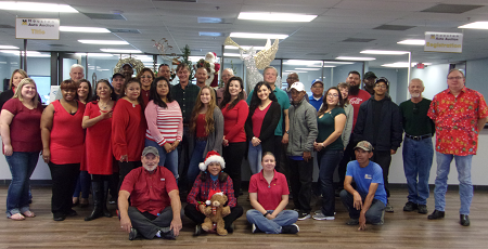 "The team at Houston Auto Auction prepares for its annual Christmas Sale on December 18. Says Grew Lawson, the auction's assistant general manager: ""We have hundreds of years of auction experience standing here. This crew totally understands the only thing we sell is customer service, so come experience it at its be st!"""