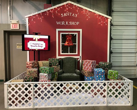 Dealers vied for the opportunity to open gifts in Santa's Workshop at Greenville Auto Auction's Big Christmas Sale in December.