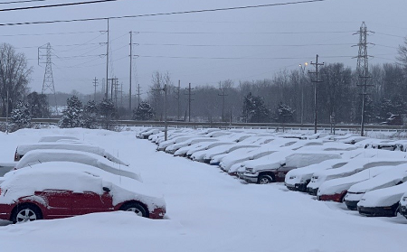 Employees at Akron Auto Auction battled more than 10 inches of snow and sub-zero temperatures in order to hold two sales.