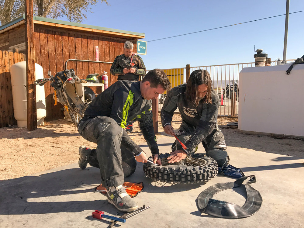 First of four flats received during our journey across the Mojave desert.  Luke Takahashi and Brandon Patton showing us how it is done.