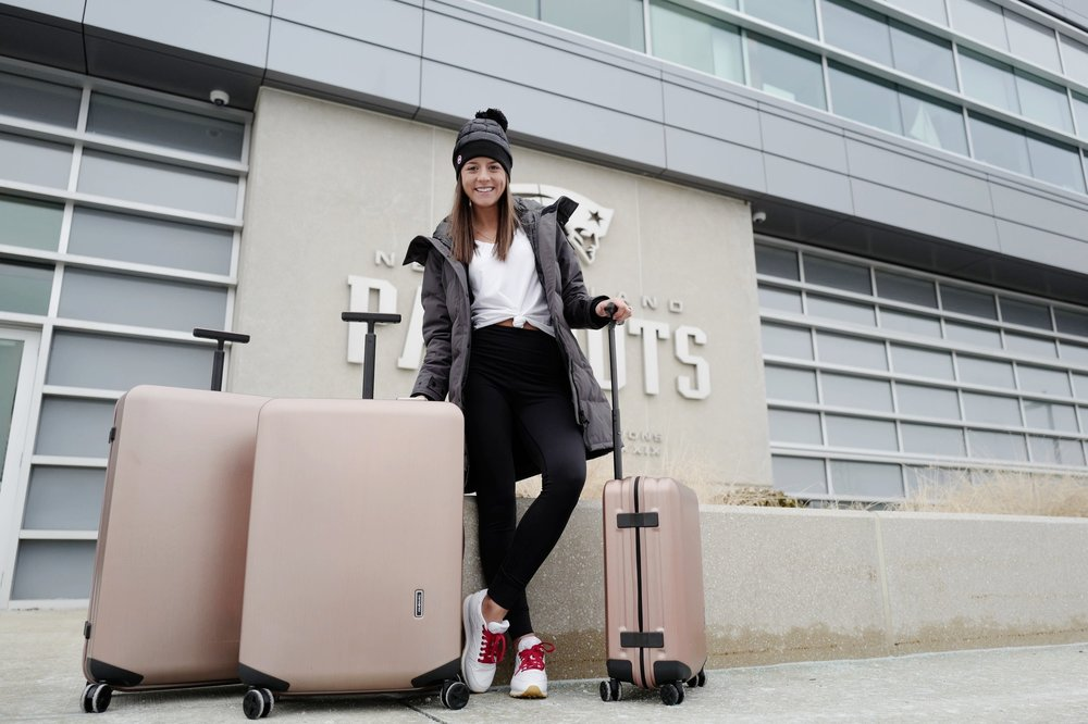 Travel luggage samsonite rose gold