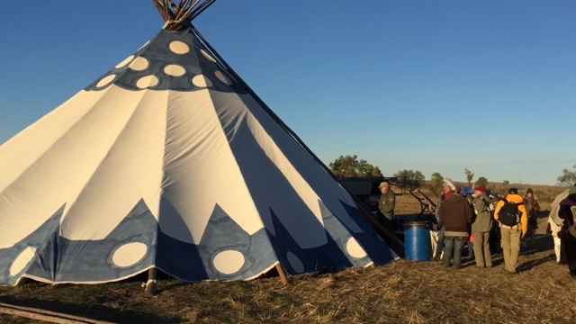 Our Crew and old gear at Camp Oceti Sakowin in October, 2016. This Rapid Response Tent is actually one of our smaller versions.