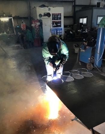 Plasma cutting my 'petals' at the Virginia School of Metal.