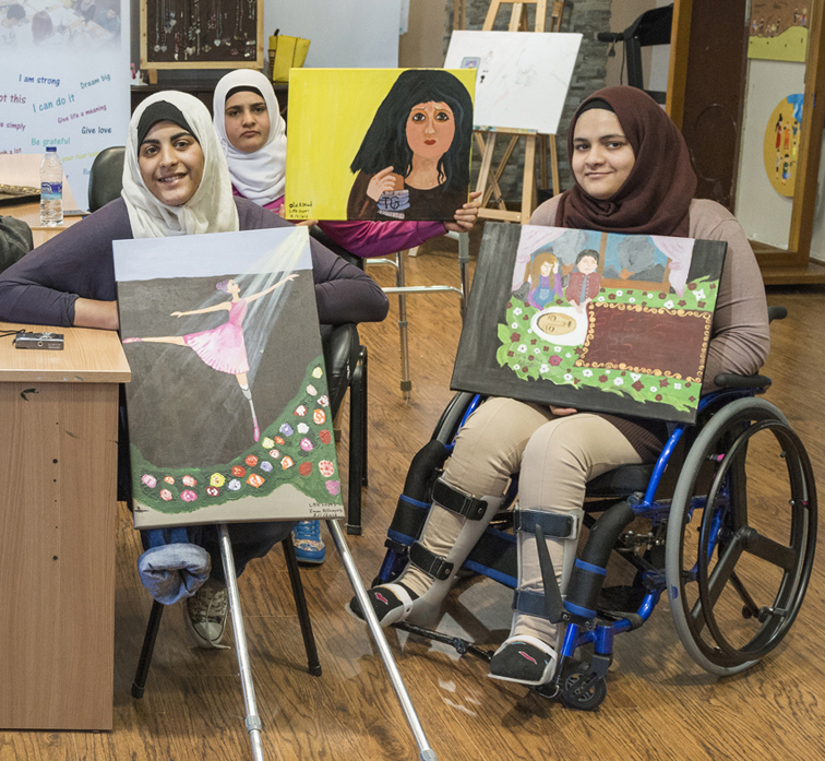 Eman Al Shayab, Ola Lakud, and Fatima Al Dayat are all recovering from war related injuries. They proudly display their artwork. photo: Stephen Petegorsky