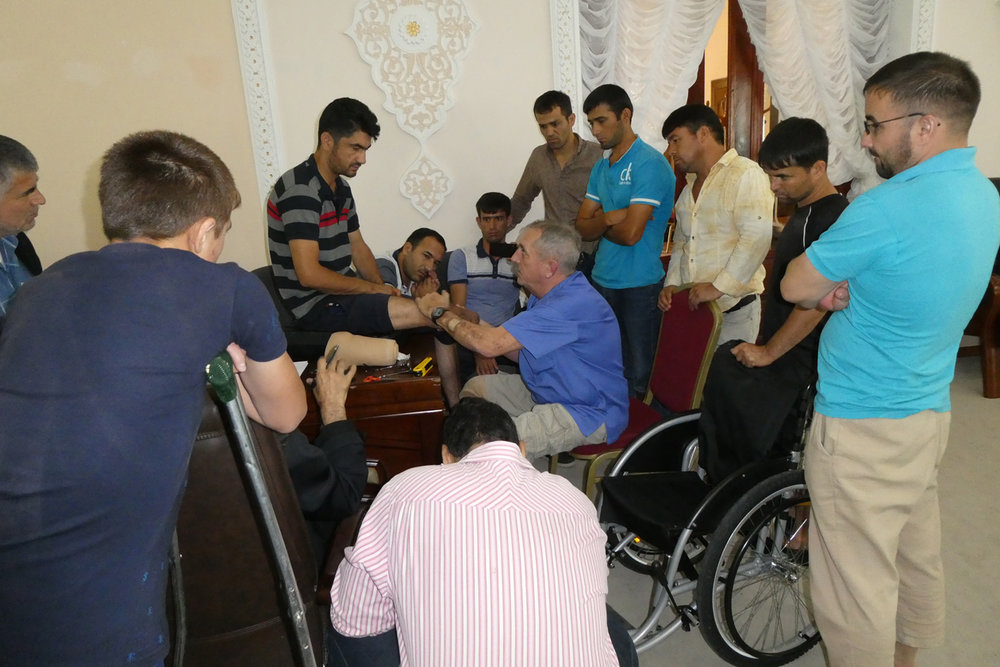 Dave Evans evaluates residual limb for Tajikistan landmine survivor
