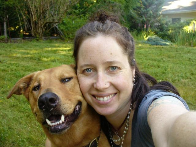 Anasuya with her dog and pendant