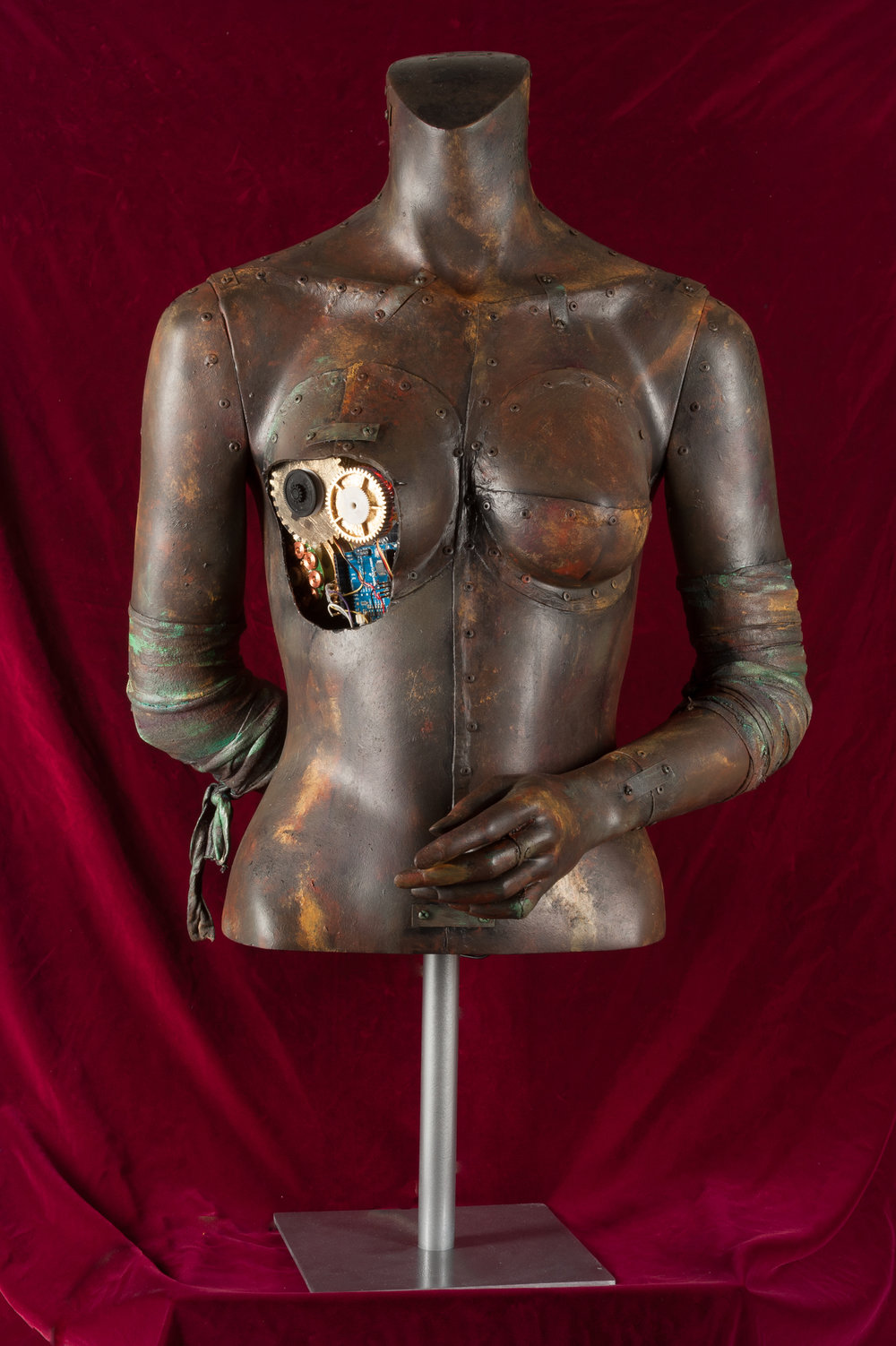 Woman of Steel - Reclaimed torso, faux paint, gilded gears, microprocessorPrivate Collection