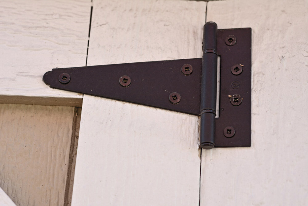 Powder coated black door hinge for a shed, playhouse or small building